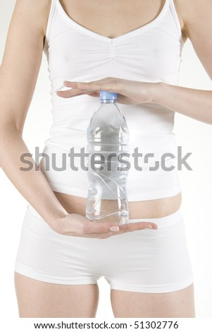 detail of woman holding bottle of  water - stock photo