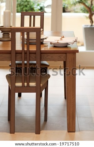 Detail of wooden dining table in the kitchen