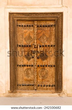 Detail of wooden door at Shaikh Isa bin Ali House in Al Muharraq, Bahrain, Middle East - stock photo