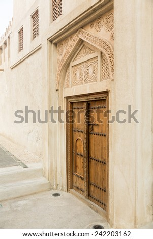 Detail of wooden door at Shaikh Isa bin Ali House in Al Muharraq, Bahrain, Middle East