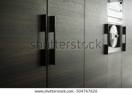 detail of wooden smoked oak kitchen doors and appliances