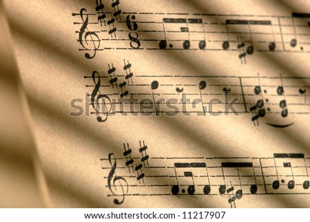 Detail of 100 year old grungy sheet music. - stock photo