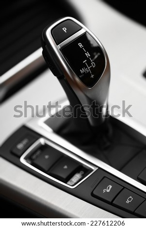 Detail on a automatic gear shifter in a new car. - stock photo