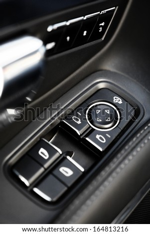 Detail on buttons controlling the windows in a car