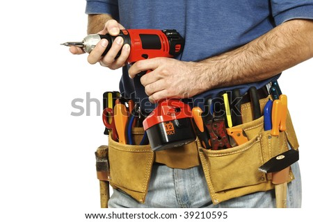 detail on handyman manual worker, toolsbelt and red drill in his hands