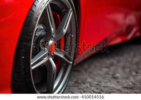 Detail on hot red super-sport car wheels with sport breaks - stock photo
