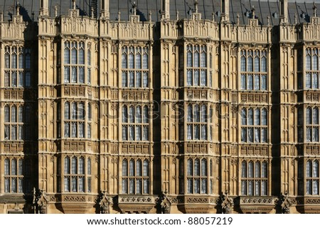 Detail on the houses of parliament, London. The building has fine architecture and is very detailed. The houses of parliament is home to UK politics.