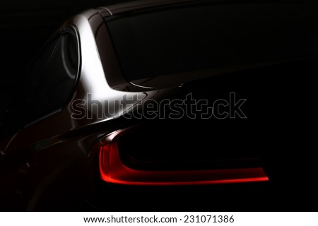 Detail on the rear light of a car. - stock photo