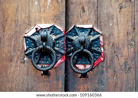 detail or rusty metal knockers - stock photo