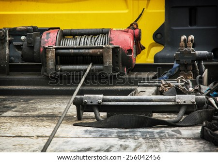 Detail photo of the car winch. - stock photo