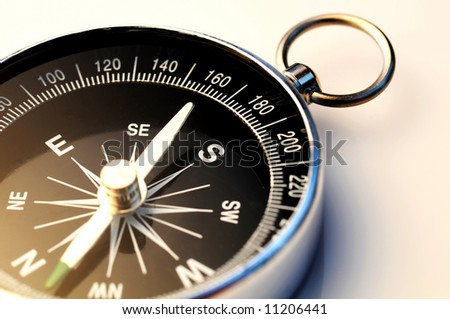 detail shot of a compass on white background, more compass pictures in my portfolio - stock photo