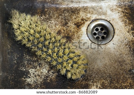 detail shot of a old dirty sink with scrubber inside - stock photo