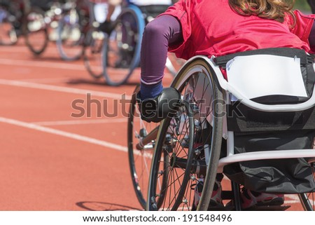 Detail shot of an athlete at a wheelchair race in a stadium - stock photo