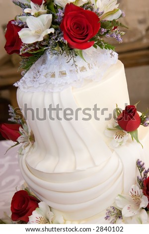 detail shot of brightly light simple three tiered wedding cake