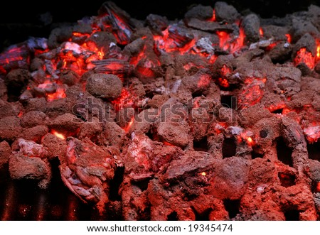 Detail shot of burning coals and embers on grill