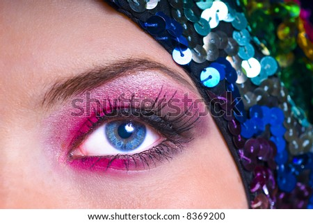 Detail shot of model with exquisite makeup and beautiful blue eye. - stock photo