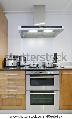 detail shot of modern electric stainless steel kitchen appliances - stock photo