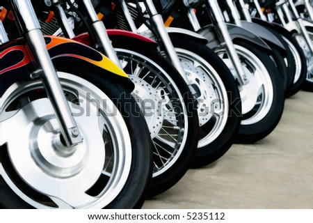 Detail shot of motorcycle front wheels. - stock photo