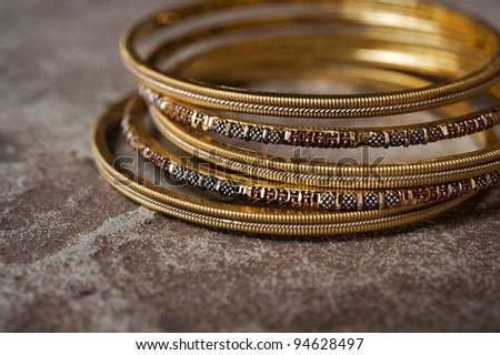 Detail shot of ornate Indian bangles for wedding - stock photo