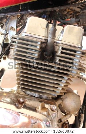 Detail shot showing the motor of a motorbike - stock photo