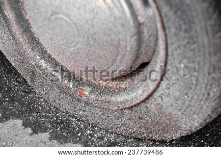 Detail shot with a old and rusty flat tire from an abandoned car - stock photo