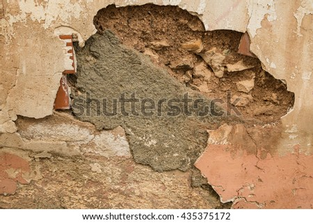 Detail take of a crumbling wall - stock photo