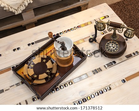 detail to the coffee table with a retro phone - stock photo