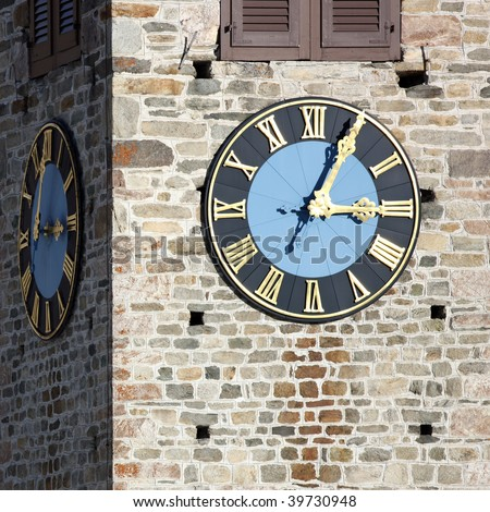 Detail view of a clock on a church tower in high resolution - stock photo