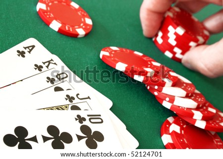 Detail view of a royal flush combination at poker with chips - stock photo