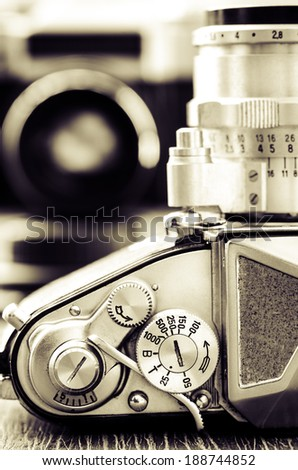 Detail view of classic camera dials with nice bokeh background in vintage style - stock photo