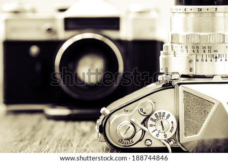 Detail view of classic cameras in monochrome vintage style - stock photo