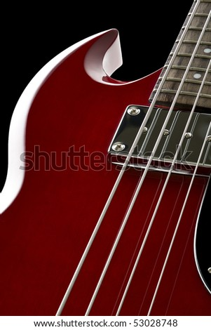 Detail view of electric bass on black - stock photo