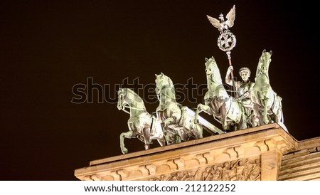 Detail view of the historic Brandenburg Gate in Berlin, Germany, with the famous quadriga visible on top. - stock photo