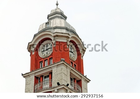 Detail view of Varna train station clock tower. The Railway station and its clock tower were built by Pitel-Brauseweter Co. in 1925. - stock photo