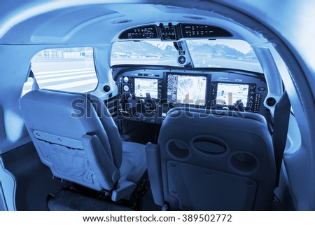 Detail view on flight simulator cockpit for small private airplanes, blue colored. - stock photo