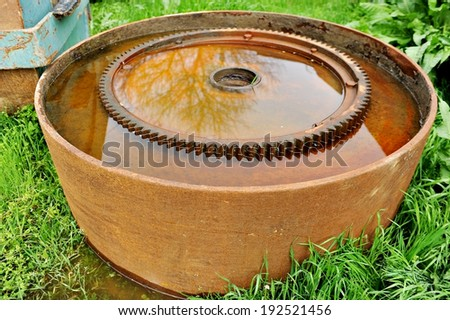 Detail with big rusty industrial sprocket wheel - stock photo