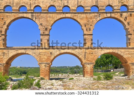 Detail with the stone arches of Pont du Gard - an ancient aqueduct near Nimes, France