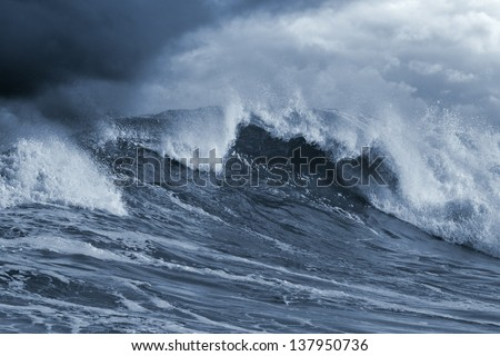Detailed Atlantic stormy big wave; toned blue, enhanced sky - stock photo