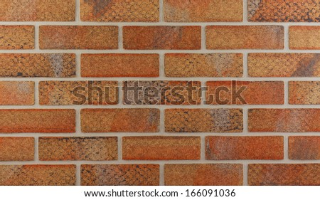 Detailed background of brown brick wall texture - stock photo