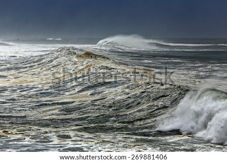 Detailed big stormy waves approaching the Portuguese coast - stock photo