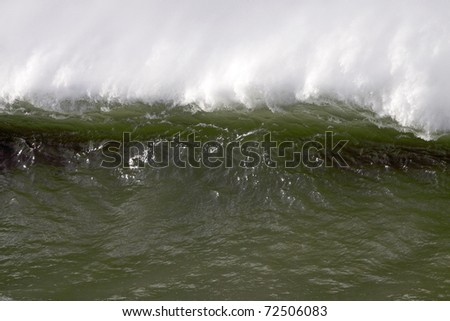 Detailed big white and green wave during a storm in the north Portuguese coast