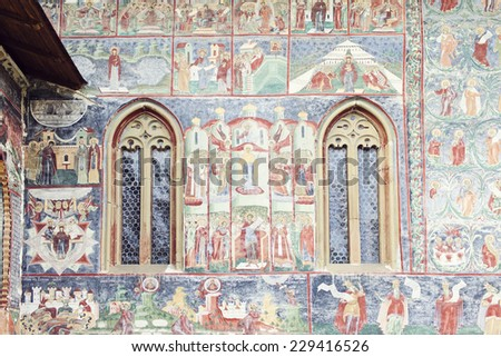 detailed image of painted wall and windows of Sucevita Monastery, Bucovina, Romania