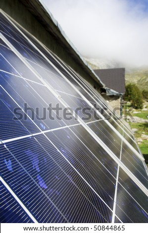 detailed perspective of a solar panel on the roof of a house - stock photo