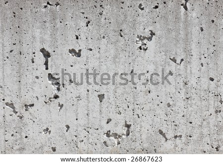 Detailed photo of an aged concrete wall showing all the pores in the material - stock photo