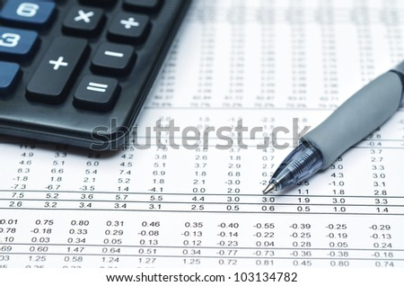 Detailed shot of financial report, ballpoint and calculator. Can be use as Illustration of financial business, math work, accounting, office work, business economy or general business etc.