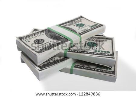 Detailed shot of stack of bundles of US dollars on white background. - stock photo