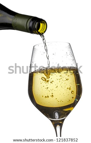 Detailed shot of wine bottle pouring wine in wine glass. - stock photo