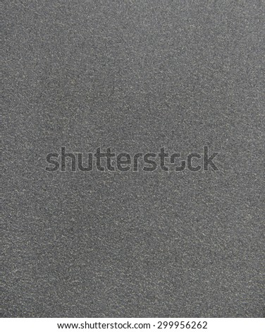 Detailed texture of black stone material - stock photo