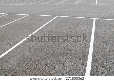 Detailed View of a Vacant Parking Lot - stock photo