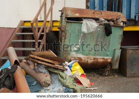 Detailed view of an old container on landfill - stock photo